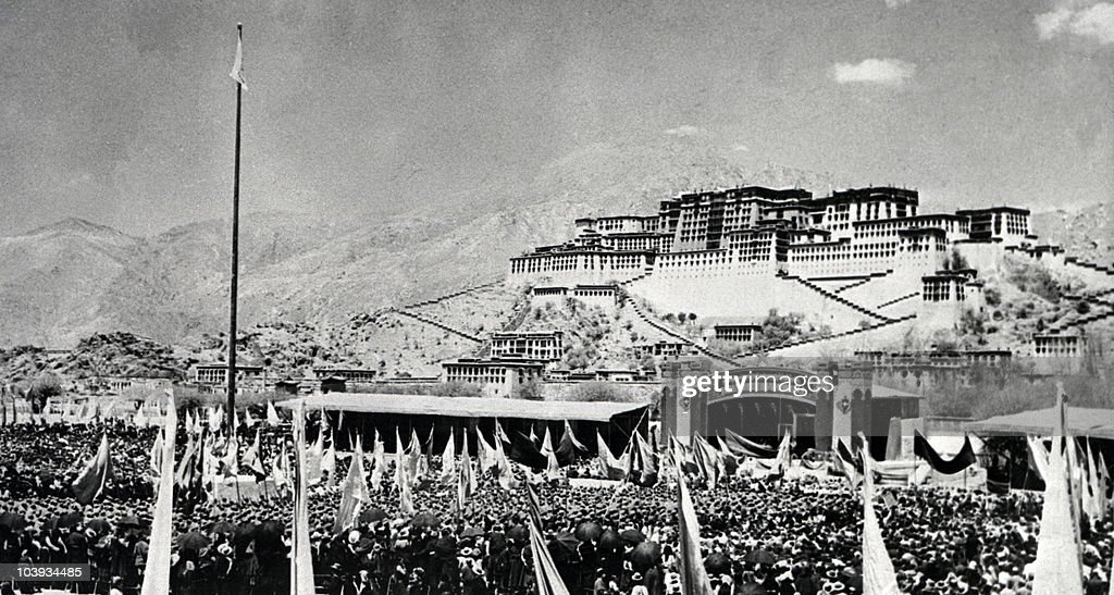 Tibetans gather during armed uprising against Chinese rule March 10, 1959 in front of the Potala Palace (former home of the Dalai Lama) in Lhasa, the capital of Tibet (Xizang). As a result, the Dalai Lama, the head of Tibet's Buddhist clergy and thus the region's spiritual leader, fled with some 100,000 supporters to northern India, where a government-in-exile was established. The Chinese ended the the former dominance of the lamas (Buddhist monks) and destroyed many monasteries. Tibet (Xizang), occupied in 1950 by Chinese Communist forces, became an 'Autonomous Region' of China in September 1965, but the majority of Tibetans have continued to regard the Dalai Lama as their 'god-king' and to resent the Chinese presence, leading to intermittent unrest.