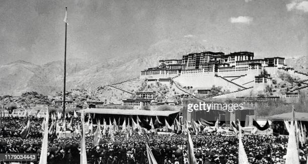 Tibetans gather during armed uprising against Chinese rule March 10, 1959 in front of the Potala Palace in Lhasa, the capital of Tibet . As a result,...