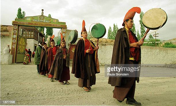 Tibetans monks from the Karma Dupgyud Choeling Monastery parade in traditional robes to celebrate the end of a special puja June 1 2001 in Choglamsar...