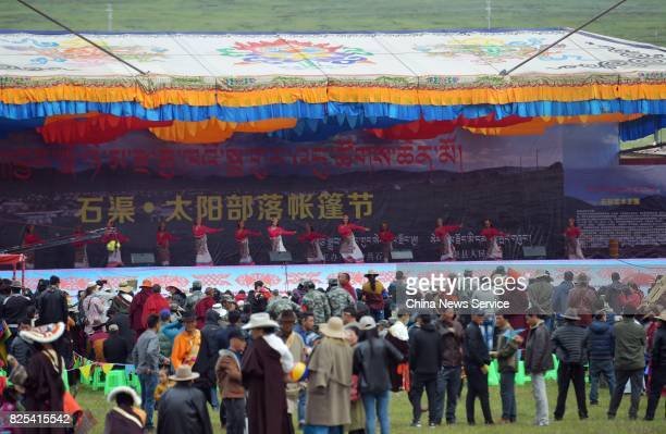 Tibetans perform during a tent festival on a grassland 4500 meters above sea level on August 1 2017 in Shiqu County Sichuan Province of China