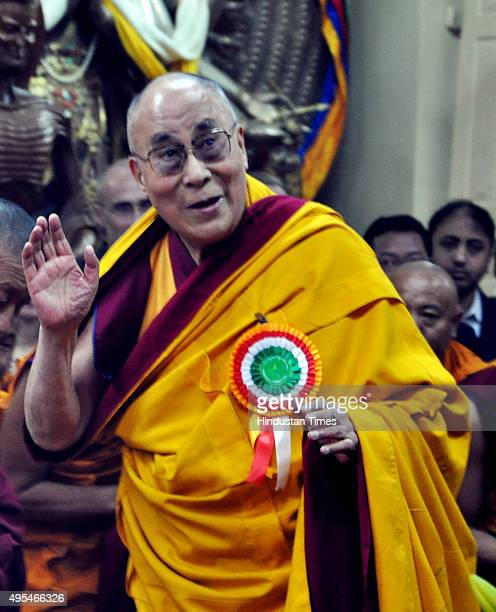 Tibetans spiritual leader the 14th Dalai Lama greets devotees as he arrives for oneday teaching on empowerment and how to generate compassion at the...