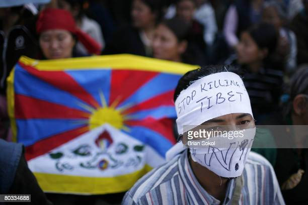 Tibetans stage a protest in front of the UN building on March 15 2008 in Kathmandu Nepal Tibetans have been protesting against Chinese rule since...