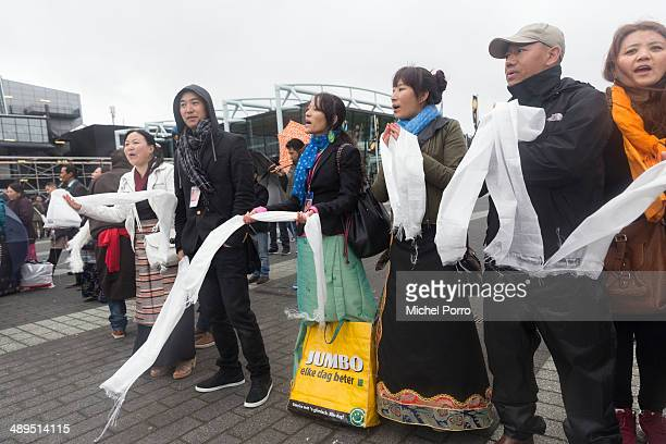 Tibetans wait for the Dalai Lama on the second day of the threeday visit on 11 May 2014 in Rotterdam Netherlands