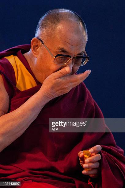 Tibet's exiled spiritual leader Tenzin Gyatso the 14th Dalai Lama gestures during an open public talk at the Pavilion of Anhembi in Sao Paulo Brazil...