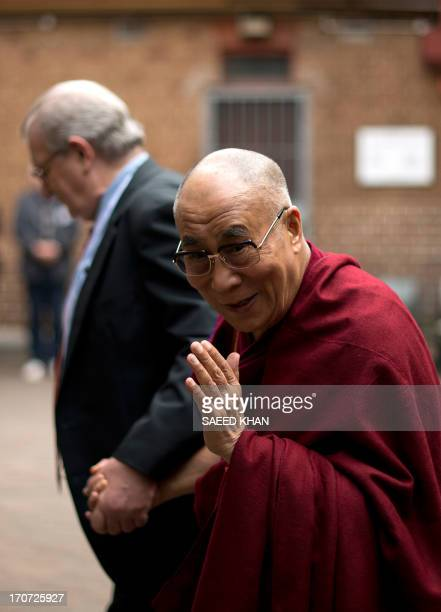 Tibet's exiled spiritual leader the Dalai Lama gestures as he walks towards the church with Reverand Bill Crews suprintendents minister of Ashfield...