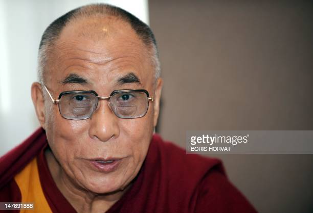 Tibet's spiritual leader the Dalai Lama looks on after his arrival at Roissy airport north of Paris on June 6 2009 Dalai Lama will meet with the...