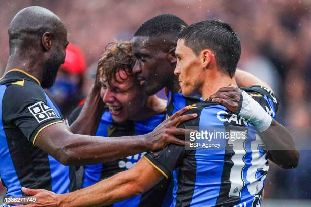 Tibo Persyn of Club Brugge celebrates after scoring his sides third goal with Stanley Nsoki of Club Brugge and Federico Ricca of Club Brugge during...