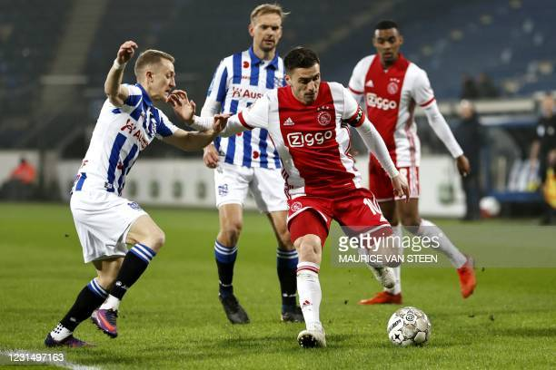 Tibor Halilovic of sc Heerenveen fights for the ball with Dusan Tadic or Ajax during the KNVB Cup semi-final match between sc Heerenveen and Ajax...