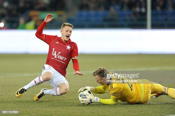 Tibor Halilovic of Wisla Krakow competes with Jakub Slowik of Slask Wroclaw during Lotto Ekstraklasa match between Wisla Krakow and Slask Wroclaw on...