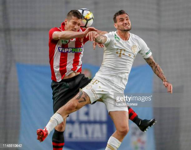 Tibor Heffler of Budapest Honved wins the ball in the air from Davide Lanzafame of Ferencvarosi TC during the Hungarian OTP Bank Liga match between...