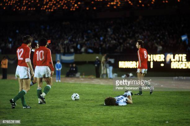 Tibor Nyilasi of Hungary No 8 receives a red card after fouling Alberto Tarantini of Argentina