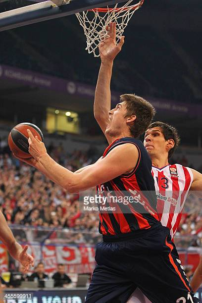 Tibor Pleiss, #21 of Laboral Kutxa Vitoria competes with Boban Marjanovic, #13 of Crvena Zvezda Telekom Belgrade in action during the 2013-2014...