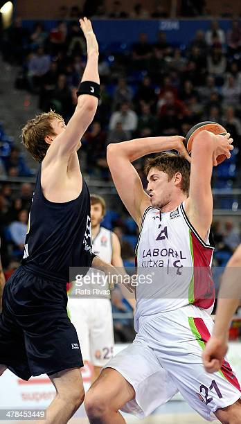 Tibor Pleiss #21 of Laboral Kutxa Vitoria competes with CJ Wallace #30 of EA7 Emporio Armani Milan during the 20132014 Turkish Airlines Euroleague...