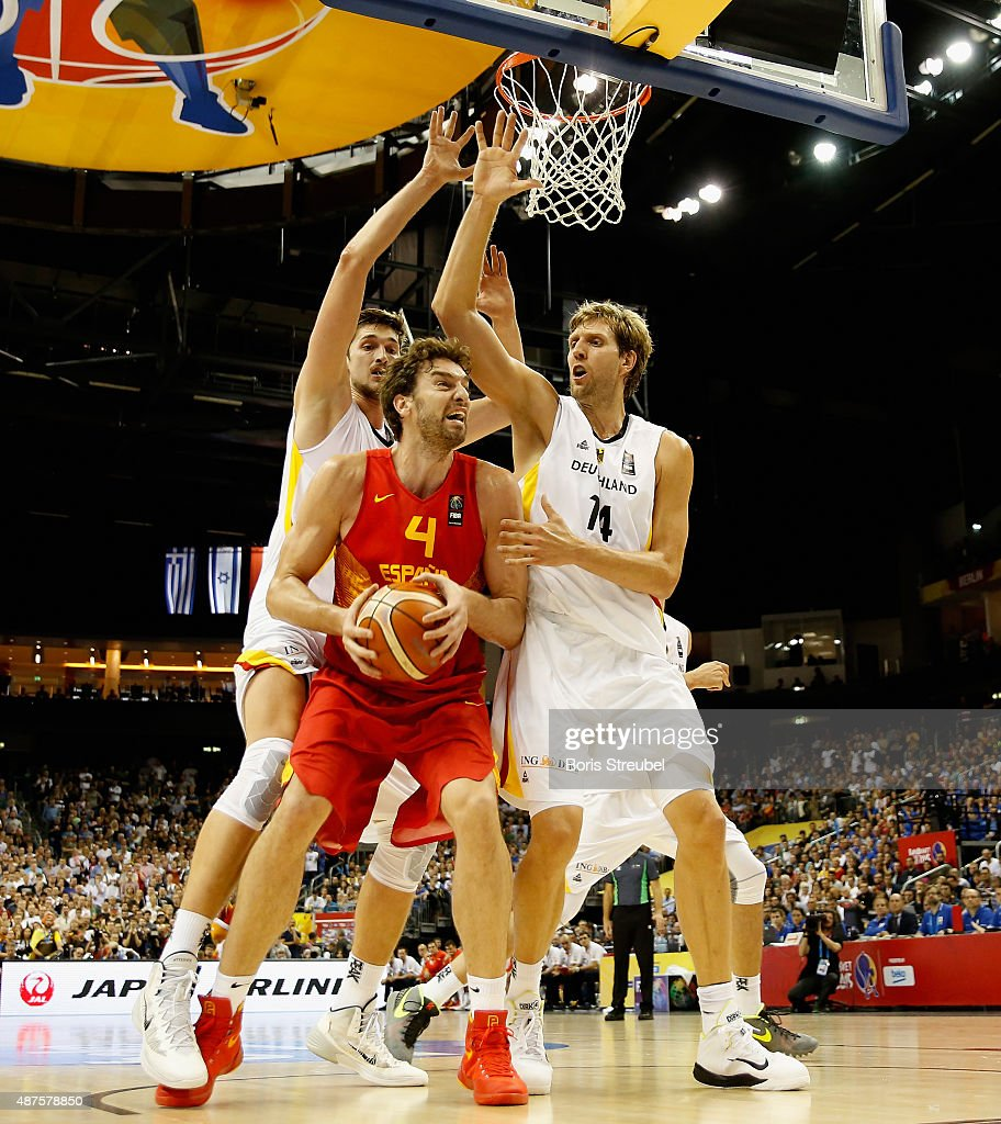 Tibor Pleiss (L) and Dirk Nowitzki (R) of Germany trie to block Pau Gasol (C) of Spain during the FIBA EuroBasket 2015 Group B basketball match between Germany and Spain at Arena of EuroBasket 2015 on September 10, 2015 in Berlin, Germany.
