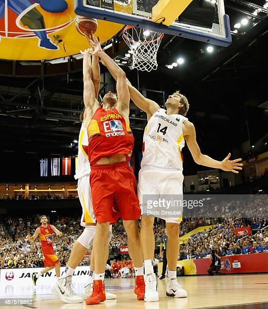 Tibor Pleiss and Dirk Nowitzki of Germany trie to block Pau Gasol of Spain during the FIBA EuroBasket 2015 Group B basketball match between Germany...