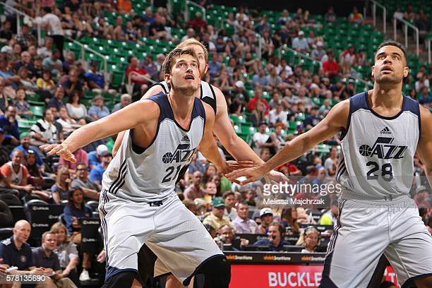 Tibor Pleiss and JJ OBrien of Utah Jazz box out against the San Antonio Spurs during the 2016 Utah Summer League at vivintSmartHome Arena on July 4...