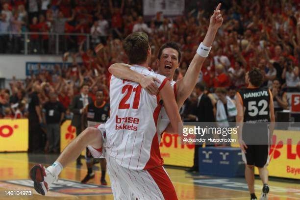 BAMBERG GERMANY JUNE Tibor Pleiss of Bamberg celebrates victory with his team mate Casey Jacobsen after winning game 3 of the Beko BBL finals between...