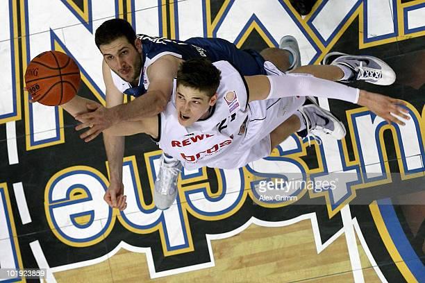 Tibor Pleiss of Brose Baskets is challenged by Dragan Labovic of Frankfurt during the Beko Basketball Bundesliga play off final match between...