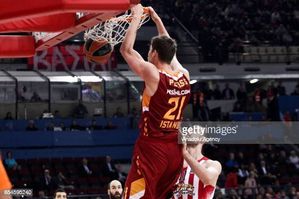 Tibor Pleiss of Galatasary Odebank dunks the ball during the Turkish Airlines Euroleague Basketball match between Olympiacos Piraeus and Galatasaray...
