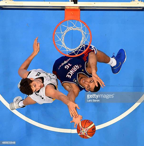 Tibor Pleiss of Germany challenges Rudy Gobert of France during the Men's Basketball friendly match between Germany and France at Lanxess Arena on...