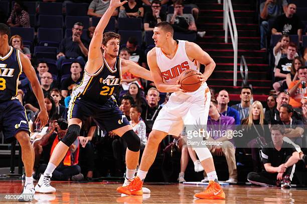 Tibor Pleiss of the Utah Jazz guards Alex Len of the Phoenix Suns on October 9 at Talking Stick Resort Arena in Phoenix Arizona NOTE TO USER User...