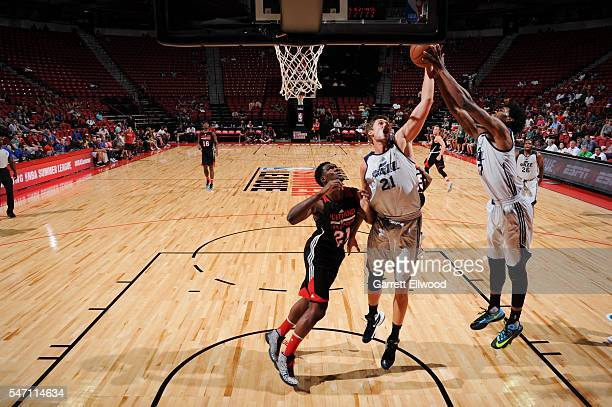 Tibor Pleiss of Utah Jazz reaches for the rebound against the Portland Trailblazers during the 2016 Las Vegas Summer League on July 13 2016 at the...