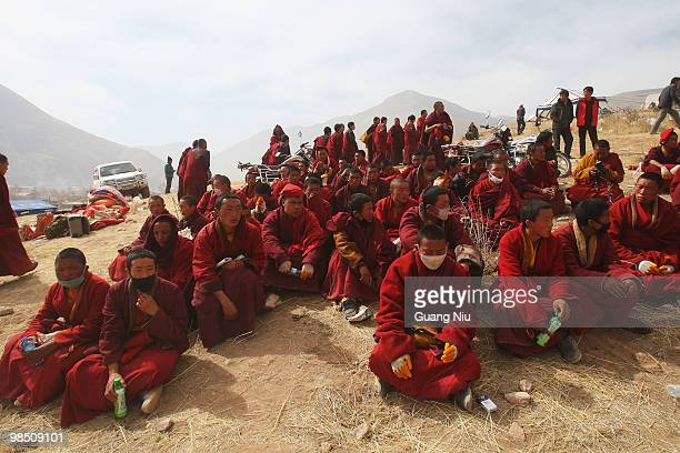Tibrtan monks pary for vicitm during a fire funeral following a strong earthquake on Jiegu toweship of China's Qinghai province just on April 17,...
