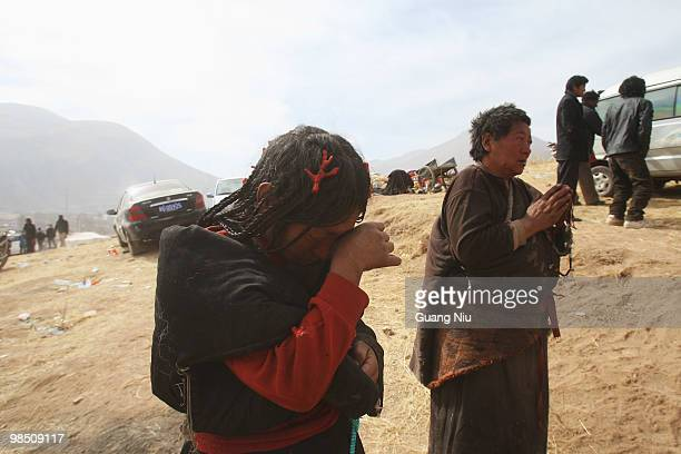 Tibrtan woman cry during a mass cremation for the of a strong earthquake on Jiegu toweship of China's Qinghai province just on April 17, 2010 in...