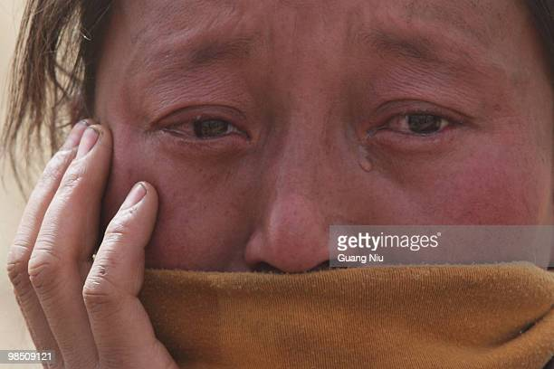 Tibrtan woman cry during a mass cremation for the vicitms following a strong earthquake on Jiegu toweship of China's Qinghai province just on April...