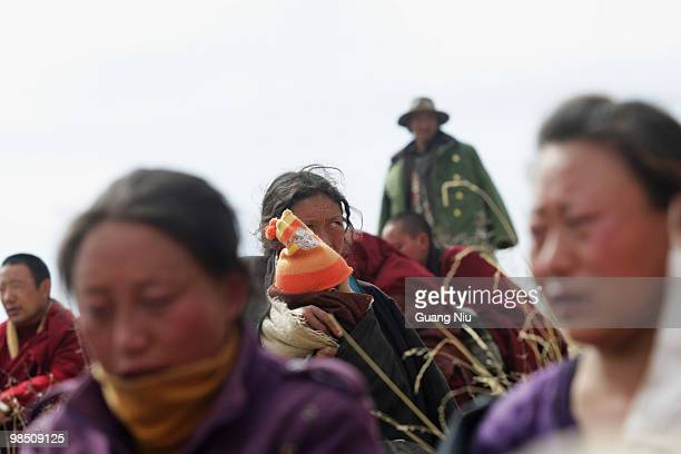 Tibrtan woman reacts during a mass cremation for the vicitms of a strong earthquake on Jiegu toweship of China's Qinghai province just on April 17,...