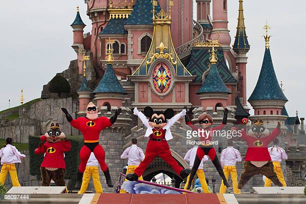 Tic & Tac, Mr Indestructible, Mickey and Elastigirl perform during a show in the front of the Cinderella Castle during the New Generation Year Launch...