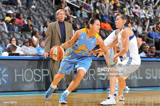 Ticha Penicheiro of the Chicago Sky dribbles against Kelly Miller of the New York Liberty during the game on May 14 2012 at the Prudential Center in...