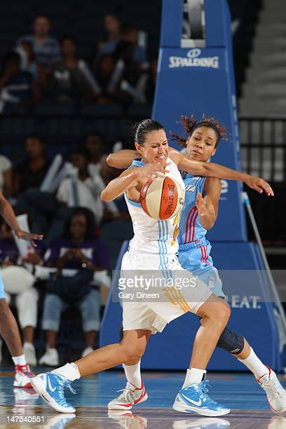 Ticha Penicheiro of the Chicago Sky drives on Lindsey Harding of the Atlanta Dream on July 1 2012 at the Allstate Arena in Rosemont Illinois NOTE TO...