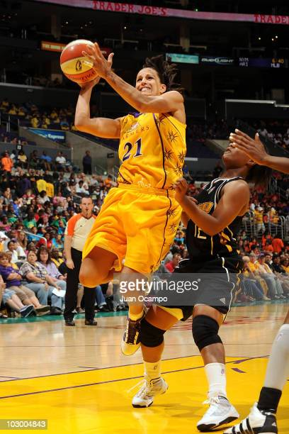 Ticha Penicheiro of the Los Angeles Sparks goes to the basket against Ivory Latta of the Tulsa Shock on July 20 2010 at Staples Center in Los Angeles...