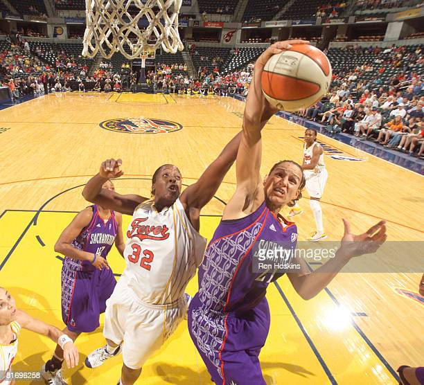Ticha Penicheiro of the Sacramento Monarchs battles Ebony Hoffman of the Indiana Fever at Conseco Fieldhouse June 24 2008 in Indianapolis Indiana...