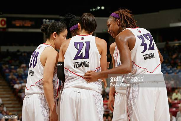 Ticha Penicheiro of the Sacramento Monarchs huddles with teammates during the WNBA game against the Chicago Sky on June 29 2007 at ARCO Arena in...