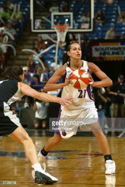 Ticha Penicheiro of the Sacramento Monarchs looks to pass the ball against the San Antonio Silver Stars during the game at Arco Arena on June 24 2003...