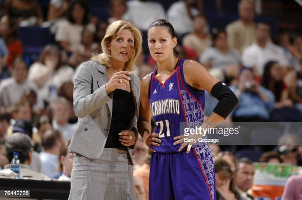 Ticha Penicheiro of the Sacramento Monarchs talks with head coach Jenny Boucek during the WNBA game against the Phoenix Mercury on August 19, 2007 at...