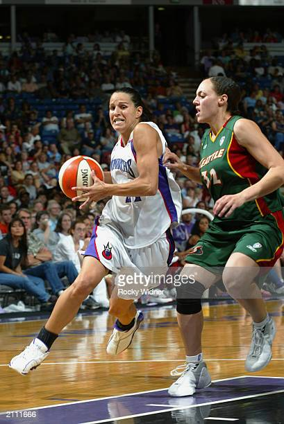 Ticha Penicheiro of the Seattle Storm drives past Adia Barnes of the Sacramento Monarchs during the game on June 21 2003 at Arco Arena in Sacramento...