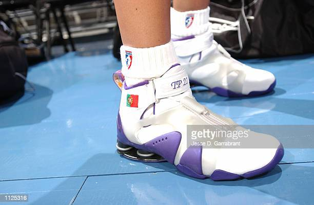 Ticha Penichiero of the Sacramento Monarchs displays her country's flag of Portugal on her sneakers during practice prior to the 2002 WNBA All Star...