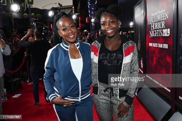 Tichina Arnold and Alijah Kai Haggins attend Halloween Horror Nights at Universal Studios Hollywood on September 12 2019 in Universal City California