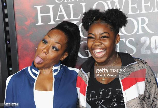 Tichina Arnold and Alijah Kai Haggins attend Opening Night Of Universal Studios' Halloween Horror Nights held at Universal Studios Hollywood on...