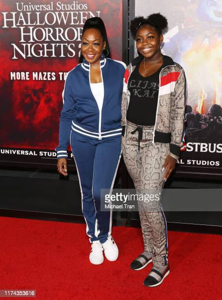 Tichina Arnold and Alijah Kai Haggins attend the opening night of Universal Studios' Halloween Horror Nights held at Universal Studios Hollywood on...