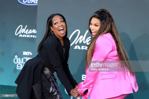 Tichina Arnold and Tisha Campbell joke around during the 2019 Soul Train Awards at the Orleans Arena on November 17 2019 in Las Vegas Nevada