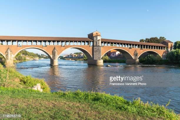 ticino river and the old bridge of pavia, italy. - イタリア パヴィア ストックフォトと画像