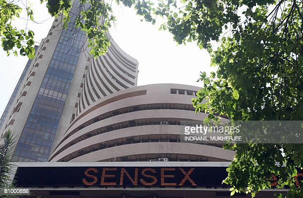 A ticker on the facade of the Bombay Stock Exchange shows India's benchmark 30share index SENSEX in Mumbai on May 6 2008 A stock market investment...