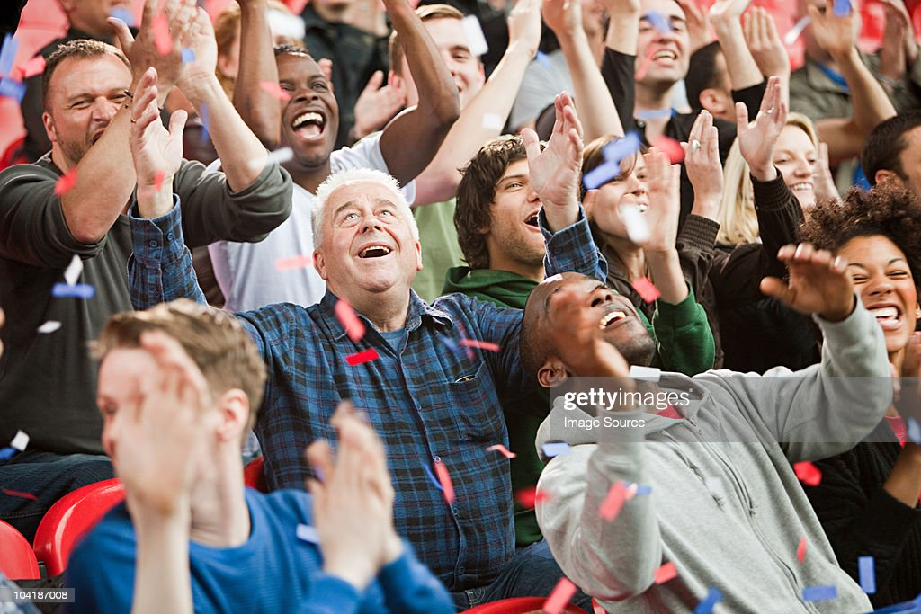 Ticker tape falling on crowd : Stock Photo