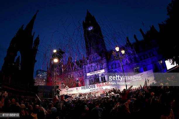 Ticker tape fills the air as members of Team GB celebrate on stage outside Manchester Town Hall in Albert Square after a Rio 2016 Victory Parade for...