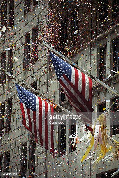 Ticker tape parade with American flags waving