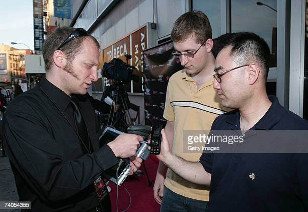 A ticket agent scans a barcode movie ticket on the screen of a wireless device at the screening of 'Heckler' hosted by Verizon Wireless during the...